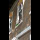 Új ablakok, a Petőfi utcai Refi alsó homlokzatán